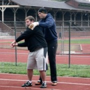 Mike Mai instructing an athlete at the October hammer clinic