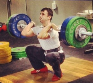 Wil Fleming cleaning. Prior to coaching, Fleming had success both as a lifter and a hammer thrower.
