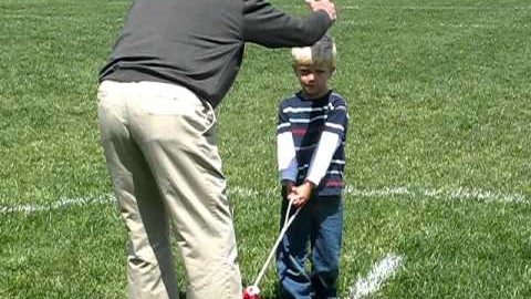 My mentor, Hal Connolly, coaching a next generation throw. There is a difference between starting to throw early and specializing in the sport at such an age.