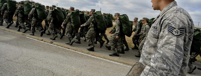 Staff Sgt. Robert George, a military training instructor at Lackland Air Force Base, Texas, marches his unit following the issuance of uniforms and gear.  Recruits are molded into warrior Airmen through a recently expanded Air Force Basic Military Training program. (U.S. Air Force photo/Master Sgt. Cecilio Ricardo)