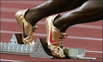 michael-johnson-sideview-200-meters-starting-blocks[1]