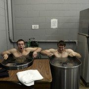 DENVER, CO - NOVEMBER 13: Metro State basketball players Nicholas Kay, left, and Mitch McCarron sit in an ice bath after practice, November 13, 2013. Kay and McCarron along with three other players on the team are from Australia. The team enters the season ranked No. 1 in Division II. (Photo by RJ Sangosti/The Denver Post via Getty Images)