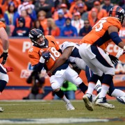 DENVER, CO - JANUARY 24: Quarterback Peyton Manning (18) of the Denver Broncos gets sacked by defensive tackle Alan Branch (97) of the New England Patriots in the second quarter. The Denver Broncos played the New England Patriots in the AFC championship game at Sports Authority Field at Mile High in Denver, CO on January 24, 2015. (Photo by Helen H. Richardson/The Denver Post via Getty Images)