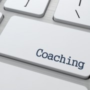 Coaching Button on Modern Computer Keyboard with Word Partners on It.