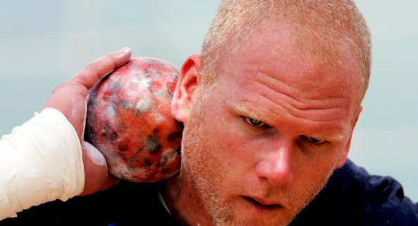 ATLANTA - JUNE 18:  John Godina competes in the shot put during the Titan Games June 18, 2004 at Centenial Olympic Park in Atlanta, Georgia.  (Photo by Matthew Stockman/Getty Images)