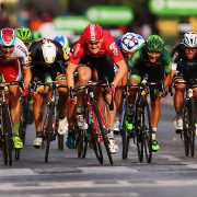 PARIS, FRANCE - JULY 26:  Andre Greipel (C) of Germany and Lotto-Soudal leads the bunch sprint to the finish line to win the twenty first stage of the 2015 Tour de France, a 109.5 km stage between Sevres and Paris Champs-Elysees, on July 26, 2015 in Paris, France.  (Photo by Bryn Lennon/Getty Images)