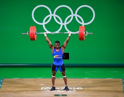 RIO DE JANEIRO, BRAZIL - AUGUST 08: Oscar Albeiro Figueroa Mosquera of Colombia competes during the Men's 62kg Group A weightlifting contest on Day 3 of the Rio 2016 Olympic Games at the Riocentro - Pavilion 2 on August 8, 2016 in Rio de Janeiro, Brazil. (Photo by Stringer/Anadolu Agency/Getty Images)